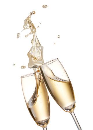 liquid splash: two glasses of champagne toasting creating splash