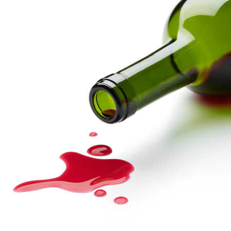 red wine stain: red wine spilling from the bottle