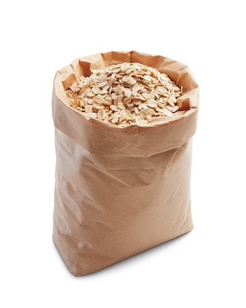 oatmeal: oatmeal in paper bag isolated on white Stock Photo