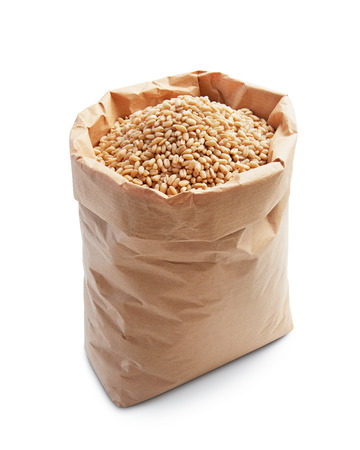 wheat kernel: wheat kernels in paper bag isolated on white Stock Photo