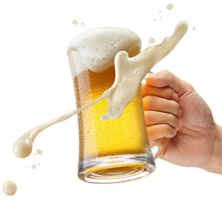 hand holding a mug of beer toasting Banco de Imagens - 63375546