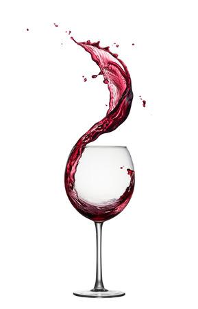 glass of splashing red wine isolated on white Foto de archivo