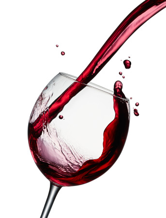 pouring a glass of red wine isolated on white