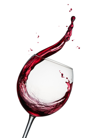 glass of splashing red wine isolated on white Foto de archivo