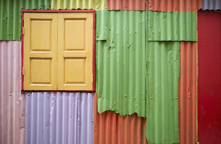 colorful zinc wall with wooden window, use as background
