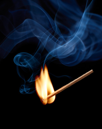matchstick with flame and smoke at the moment of ignition Stock Photo