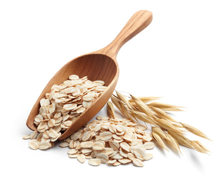 scoop and pile of oatmeal with its plant Stock Photo