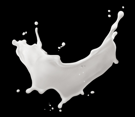 Splash of milk isolated on black