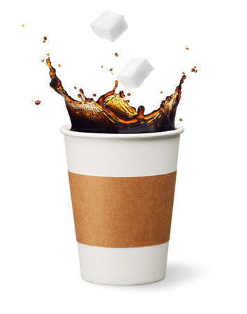 sugar cubes drop into coffee creating splash