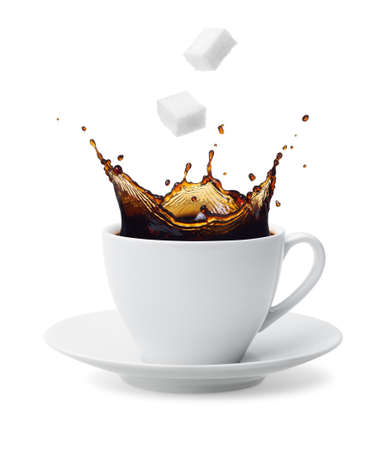 sugar cube being dropped into coffee creating splash
