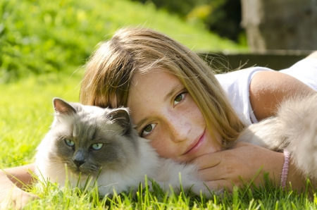 Portrait of a girl with a cat photo