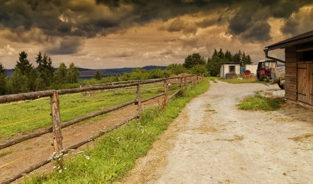 Rural landscape with dramatic cloudy sky photo