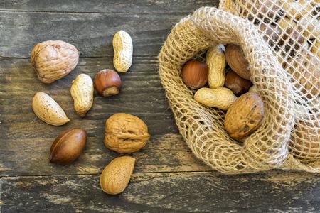 Nuts on a wooden board Reklamní fotografie
