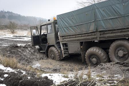Truck got stuck in the muddy road photo
