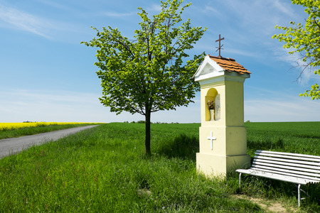 Spring landscape with a chapel in the field Reklamní fotografie