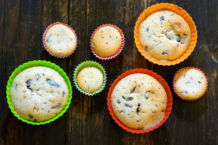 Fresh baked chocolate muffins on vintage wooden table