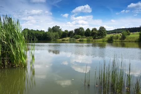 Rural landscape with lake Reklamní fotografie