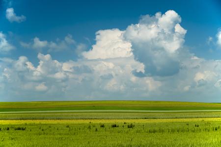 Spring landscape with white clouds on a blue sky Reklamní fotografie