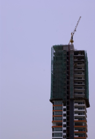 Construction of a high-rise apartment in progress photo