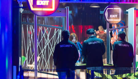 Security guard Female Asian Checking weapons in nightclub.