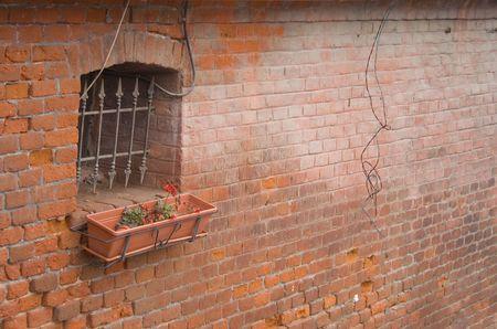 Window on a medieval wall in Sibiu, Romania. photo
