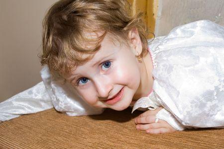 Toddler girl dressed in angel white dress playing around Stock Photo - 2290129