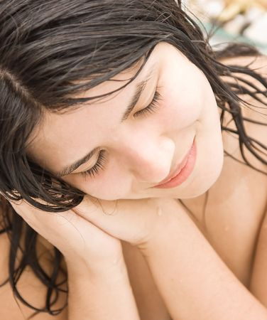 Beautiful young woman taking a bath. photo