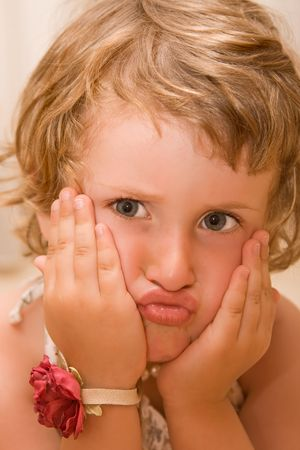 Young  girl making faces. Stock Photo - 3490909