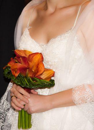 bouqet: Bride holding her flower bouqet.
