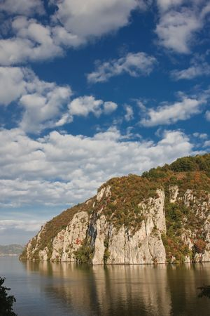 gorges: Danube Gorges reflecting in the Danube river, Romania. Stock Photo