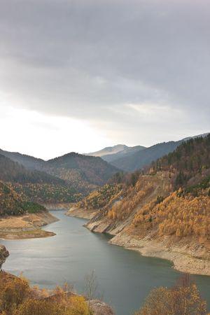 accumulation: Gura Apei lake in Retezat Mountains, Romania.
