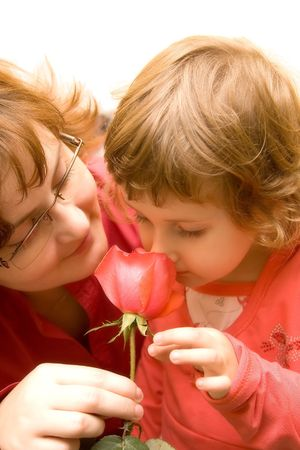 Mother and daughter smelling roses. photo