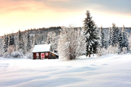 Wooden cabin in the winter.