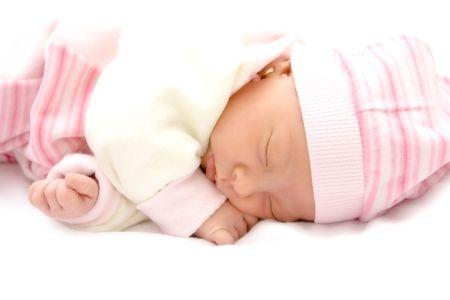 New born baby girl peacefully sleeping.