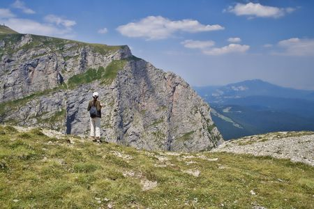 admiring: Woman admiring the landscape in Bucegi Mountains, Romania.