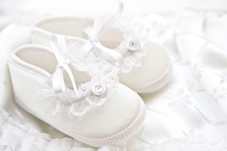 Baby girl shoes for christening. Stock Photo