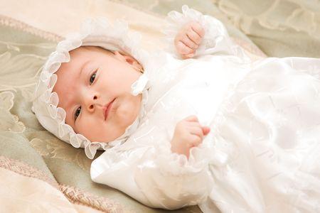 New born baby girl dressed for christening. Stock Photo