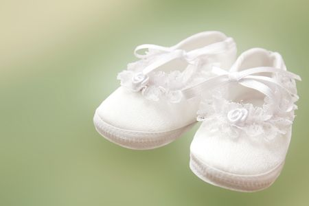 Baby girl shoes for christening. photo