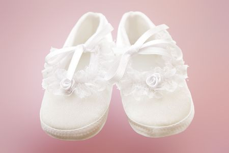 Baby girl shoes for christening. Stock Photo - 4322874