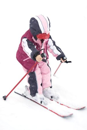 Toddler girl having fun in the snow. photo