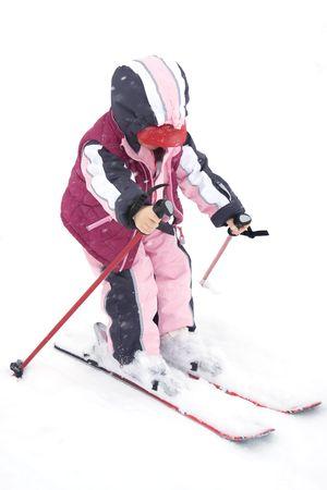 Toddler girl having fun in the snow.