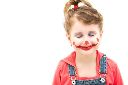 imagining: Little girl clown imagining happy thoughts