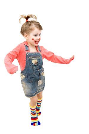 Little girl clown dancing happily Stock Photo - 4494201