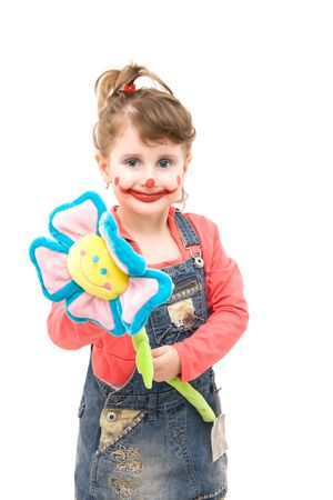 Little girl as a happy clown with a flower Stock Photo - 4494234