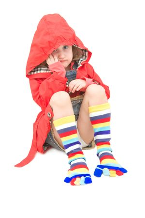 Upset little girl dressed with a red coat. Stock Photo - 4494138