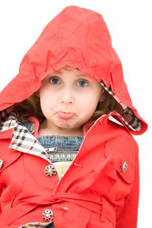 Upset little girl dressed with a red coat. Stock Photo - 4494262