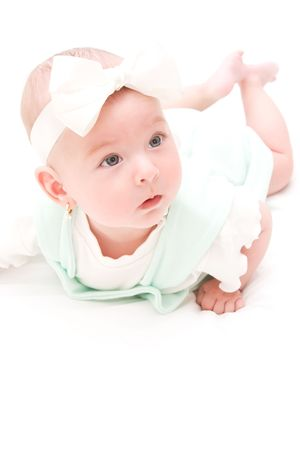 Adorable baby girl sitting on her tummy photo