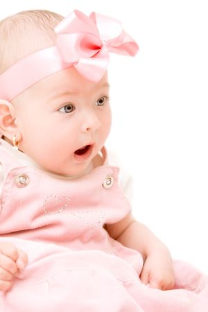 Adorable baby girl with a surprised face photo