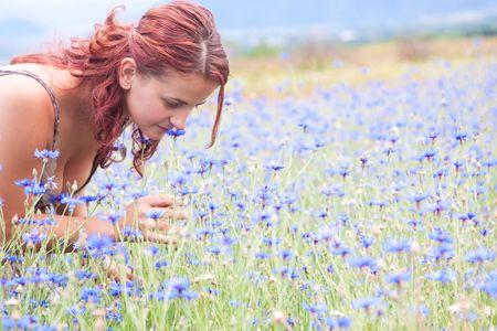 Beautiful young woman enjoying the nature photo