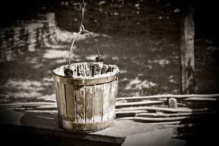 well: Old bucket in black and white Stock Photo